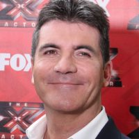 Robbers break into Simon Cowell's home while he is inside